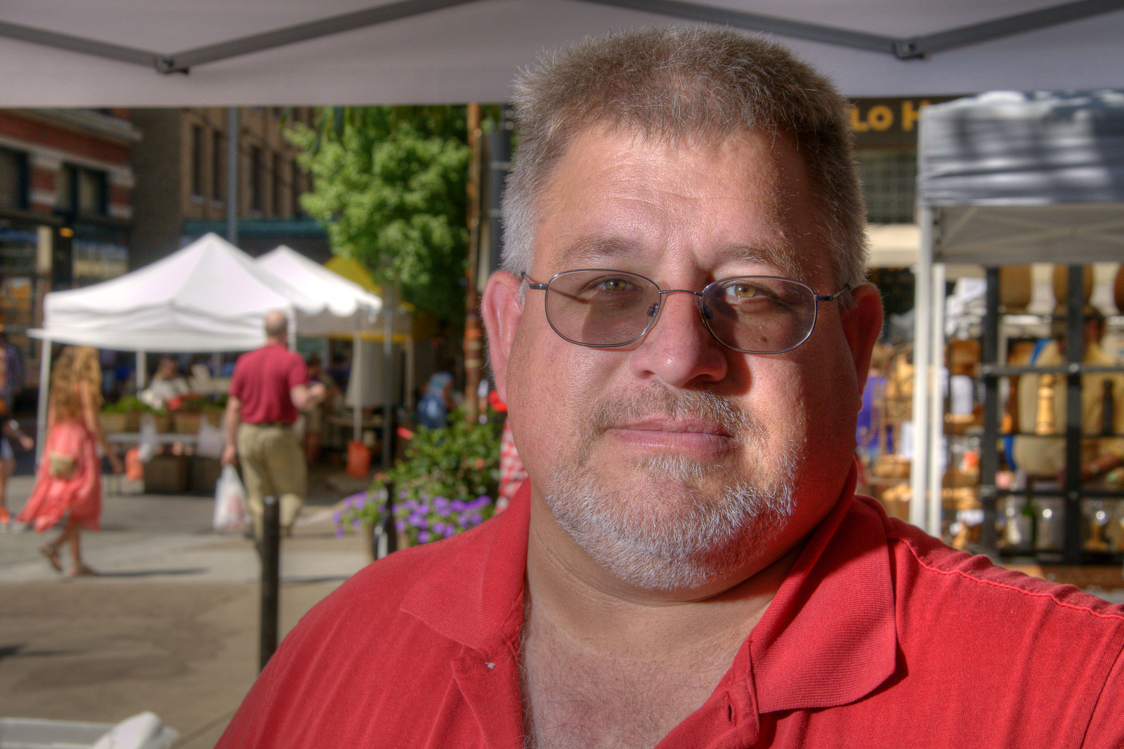 The Fruit and Berry Patch co-owner Jeff Fox poses under his tent at the Market Square Farmers' Market, an open-air market in the city's Market Square, in Knoxville, TN on Saturday, June 7, 2014. Copyright 2014 Jason Barnette