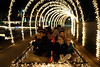 Visitors admire a light tunnel while on a hay ride during the Xfinity Christmas at Chilhowee Park in Knoxville, TN on Friday, December 12, 2014. Copyright 2014 Jason Barnette