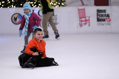 People enjoy the skating rink at Market Square in Knoxville, TN on Tuesday, December 16, 2014. Copyright 2014 Jason Barnette