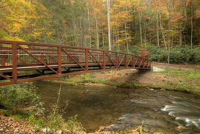 A long metal footbridge crosses the water at the beginning of the Laurel Creek Trail along Highway 91 in Laurel Bloomery, TN on Monday, October 20, 2014. Copyright 2014 Jason Barnette