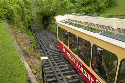 A rail car begins the long journey down the steep railroad at The Incline Railway in Lookout Mountain, TN on Wednesday, July 22, 2015. Copyright 2015 Jason Barnette