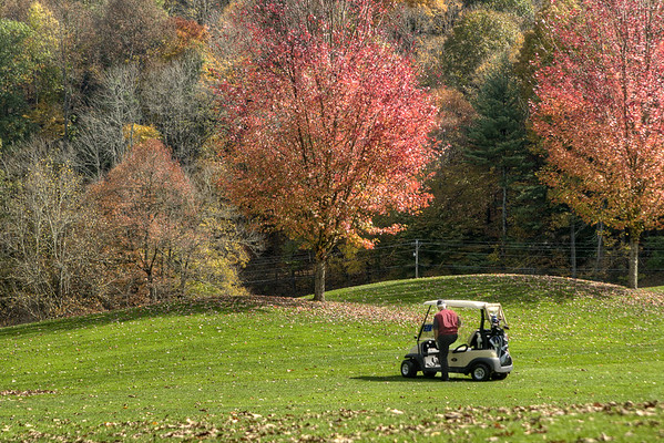 Golfers play through on a course surrounded by beautiful fall foliage at Redtail Mountain Golf Club in Mountain City, TN on Monday, October 20, 2014. Copyright 2014 Jason Barnette
