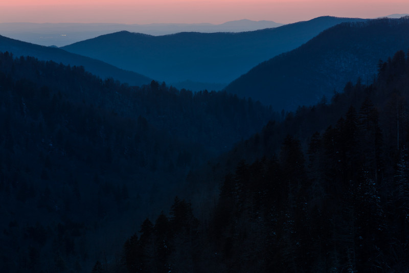 View of the sunset sky through Newfound Gap. On the distance, Gatlinburg lights start dotting the horizon. Great Smoky Mountains National Park, TN<br /> <br /> TN-130328-0176