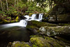 Rocks covered in moss surround one of the waterfalls of the Middle Prong of the Little River. Great Smoky Mountains National Park, TN<br /> <br /> TN-120413-0310