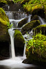 A small waterfall feeds a creek that runs parallel to the Little River. Great Smoky Mountains National Park, TN<br /> <br /> TN-120415-0049