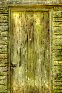 The age-worn front door of the Rice Grist Mill, built in 1798 along Lost Creek in Union County and moved to this site in after 1953 at Norris Dam State Park in Lake City, TN on Thursday, April 26, 2012. Copyright 2012 Jason Barnette