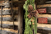 A Christmas display hanging on the covered porch of the Arnwine Cabin at the Museum of the Appalachia in Norris, TN on Saturday, December 13, 2014. Copyright 2014 Jason Barnette