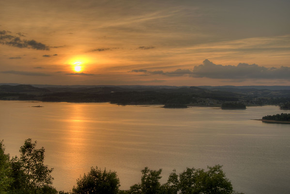 A brilliant sunset across Cherokee Lake seen from the observation area at the top of Panther Creek State Park in Morristown, TN on Friday, June 6, 2014. Copyright 2014 Jason Barnette