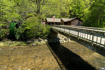 A footbridge leads across a river to the visitor's center at Roan Mountain State Park in Roan Mountain, TN on Wednesday, May 15, 2013. Copyright 2013 Jason Barnette
