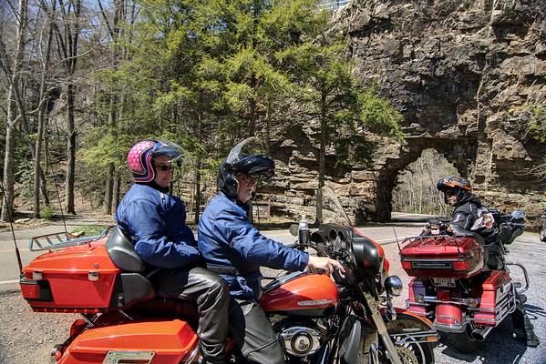 "Motorcyclists out for a ride along the curvy scenic highways stop for a view of the main attraction at the Backbone Rock Recreation Area near Shady Valley, TN on Saturday, April 5, 2014. Copyright 2014 Jason Barnette  Backbone Rock is known locally as the ""Shortest Tunnel in the World"". It is a hole about 20' deep blasted through a ridge by the Beaver Dam Railway Company around 1900 to make way for a railroad track. Today, the recreation area features a full campground, picnic area, an observation area on top of the ridge, and a trail around a waterfall nearby."