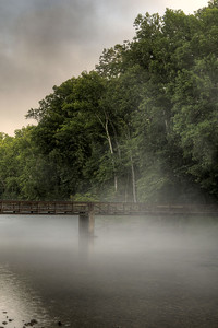 Fog shrouds the footbridge crossing the river to Osceola Island at South Holston Lake in Bristol, TN on Friday, July 25, 2014. Copyright 2014 Jason Barnette