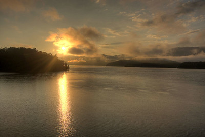 The sun rises over South Holston Lake in Bristol, TN on Friday, July 25, 2014. Copyright 2014 Jason Barnette