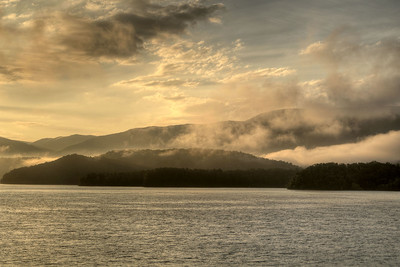 Heavy fog lingers around the mountains during sunrise at South Holston Lake in Bristol, TN on Friday, July 25, 2014. Copyright 2014 Jason Barnette