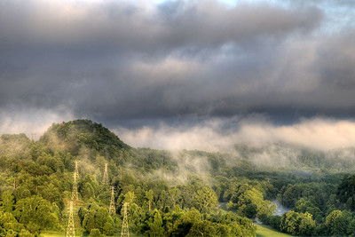 Fog clings to the mountains near a series of power lines running from the hydroelectric power state at South Holston Lake in Bristol, TN on Friday, July 25, 2014. Copyright 2014 Jason Barnette