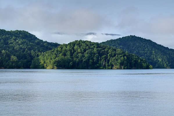 Fog clings to the mountains in the early morning hours at South Holston Lake in Bristol, TN on Friday, July 25, 2014. Copyright 2014 Jason Barnette