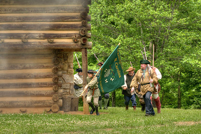 Reenactors march outside the fort to face the Native Americans during the Siege of Fort Watauga at Sycamore Shoals State Park in Elizabethton, VA on Saturday, May 17, 2014. Copyright 2014 Jason Barnette  The Siege of Fort Watauga is a two-day reenactment held each year at the recreation of the fort inside Sycamore Shoals State Historic Park. The reenactment brings in dozens of reenactors and hundreds of visitors as they tell the story of an attack on the early settlers village by Dragging Canoe, and how they successfully defended themselves. During the reenactment, the fort is open to the public with demonstrations of all areas of early settler life on the frontiers.