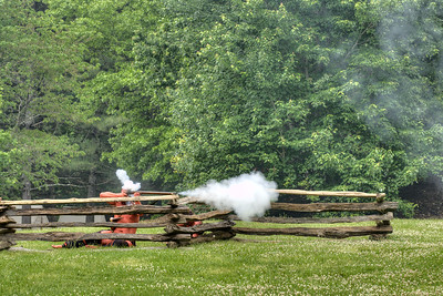 A Native American reenactor fires his rifle during the Siege of Fort Watauga at Sycamore Shoals State Park in Elizabethton, VA on Saturday, May 17, 2014. Copyright 2014 Jason Barnette  The Siege of Fort Watauga is a two-day reenactment held each year at the recreation of the fort inside Sycamore Shoals State Historic Park. The reenactment brings in dozens of reenactors and hundreds of visitors as they tell the story of an attack on the early settlers village by Dragging Canoe, and how they successfully defended themselves. During the reenactment, the fort is open to the public with demonstrations of all areas of early settler life on the frontiers.