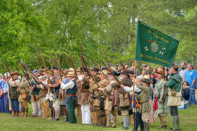 Reenactors march in front of the large crowd that had gathered to watch the Siege of Fort Watauga at Sycamore Shoals State Park in Elizabethton, VA on Saturday, May 17, 2014. Copyright 2014 Jason Barnette  The Siege of Fort Watauga is a two-day reenactment held each year at the recreation of the fort inside Sycamore Shoals State Historic Park. The reenactment brings in dozens of reenactors and hundreds of visitors as they tell the story of an attack on the early settlers village by Dragging Canoe, and how they successfully defended themselves. During the reenactment, the fort is open to the public with demonstrations of all areas of early settler life on the frontiers.