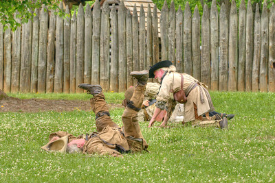 """One of the """"fallen"""" settler reenactors has a little fun after the Siege of Fort Watauga at Sycamore Shoals State Park in Elizabethton, VA on Saturday, May 17, 2014. Copyright 2014 Jason Barnette  The Siege of Fort Watauga is a two-day reenactment held each year at the recreation of the fort inside Sycamore Shoals State Historic Park. The reenactment brings in dozens of reenactors and hundreds of visitors as they tell the story of an attack on the early settlers village by Dragging Canoe, and how they successfully defended themselves. During the reenactment, the fort is open to the public with demonstrations of all areas of early settler life on the frontiers."""