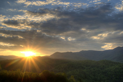 The sun sets across the mountains at an Interstate 26 Scenic Overlook near Erwin, TN on Sunday, May 10, 2015. Copyright 2015 Jason Barnette