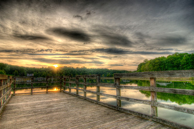 The sun sets across Fort Patrick Henry Lake at the fishing pier at Warriors Path State Park in Kingsport, TN on Monday, April 30, 2012. Copyright 2012 Jason Barnette