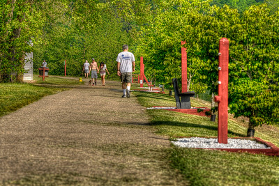 People enjoy the walking/jogging path at Warriors Path State Park in Kingsport, TN on Wednesday, May 2, 2012. Copyright 2012 Jason Barnette