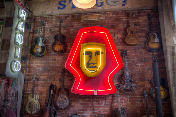 A neon sign in the Antique Archeology shop.
