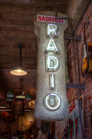 A neon sign for Nashville Radio lights up the corner of Antique Archeology.