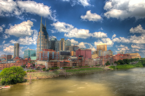 With a blue skied backdrop, overhead clouds cast shadows across the city of Nashville Tennessee.