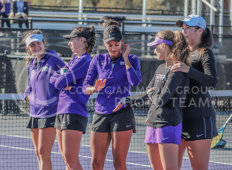 Junior Karine-Marion Job high fives teammate senior Margot Decker at the end of the first round of matches in the Fall Invitational on October 31. <br /> (Macey Franko | Collegian Media Group)