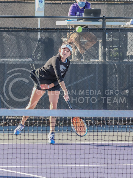 Returning the ball, junior Anna Turco finishes her swing and watches the ball. Turco competed with her doubles partner junior Ioana Gheorghita in Day 2 of the Fall Invitational where K-State hosted KU and Iowa State.<br /> (Macey Franko | Collegian Media Group)