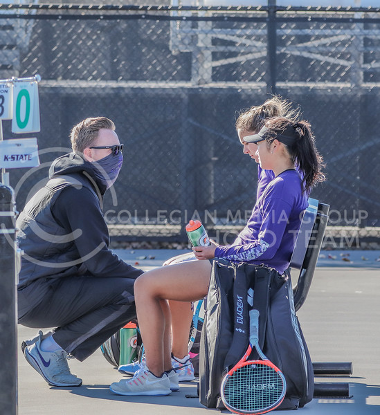 Assistant coach Tom Rees talks to the doubles team of freshman Manami Ukita and redshirt junior Rosanna Maffei between games of their match against KU in Day 2 of the Fall Invitational hosted by K-State.<br /> (Macey Franko | Collegian Media Group)