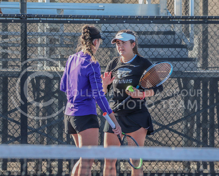 Strategizing for the next point in the match, juniors Anna Turco and Ioana Gheorghita talk during their first match of the day against Iowa State in Day 2 of the Fall Invitational.<br /> (Macey Franko | Collegian Media Group)