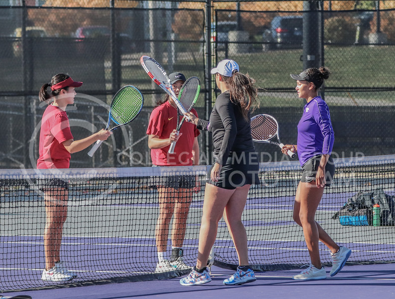 The doubles pair of juniors Karine-Marion Job and Maria Linares tap rackets with their opponents from Iowa State after winning their match 7-5 in the Fall Invitational hosted by K-State from October 30 through November 1.<br /> (Macey Franko | Collegian Media Group)
