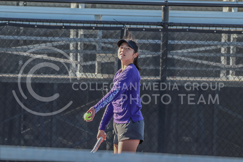 Surveying the court, freshman Manami Ukita prepares to serve the ball. Ukita competed with her doubles partner redshirt junior Rosanna Maffei on the second day of the Fall Invitational on October 31.<br /> (Macey Franko | Collegian Media Group)