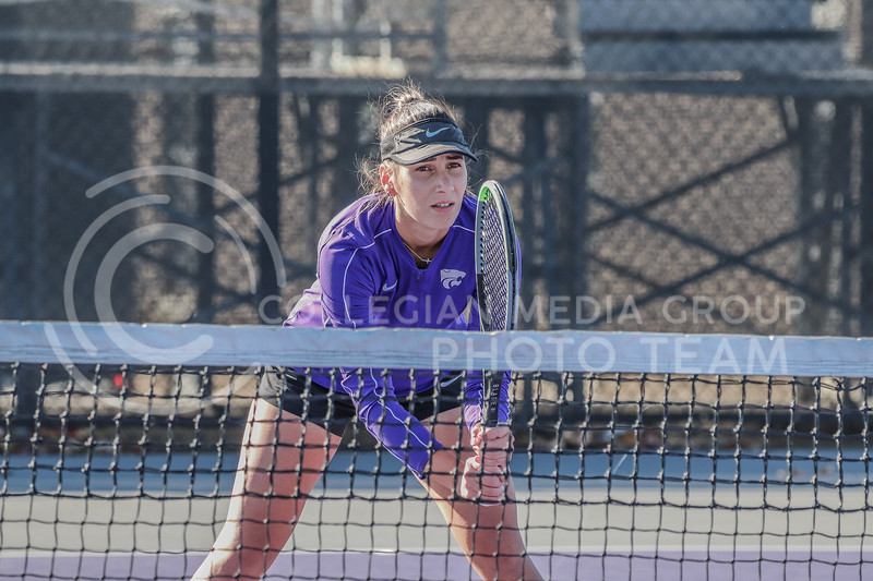 At the net, junior Ioana Gheorghita watches for the tennis ball. K-State hosted Iowa State and KU in their Fall Invitational on October 30 through November 1 at Mike Goss Tennis Stadium.<br /> (Macey Franko | Collegian Media Group)