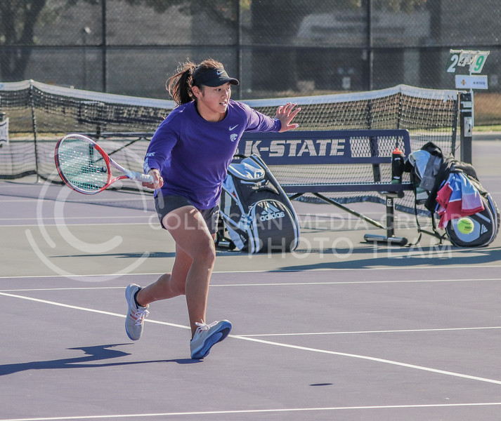 Running for the ball, freshman Manami Ukita makes an effort to get a point. K-State hosted Iowa State and K-State in a three day tournament at Mike Goss Tennis Stadium.<br /> (Macey Franko | Collegian Media Group)