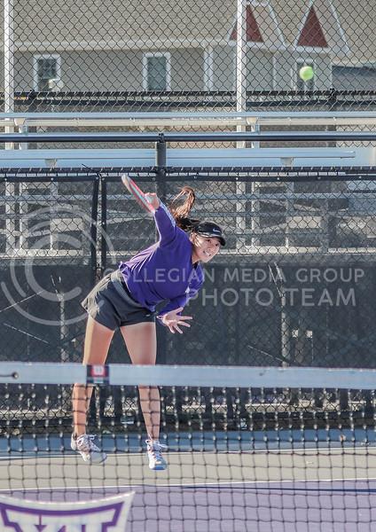Powerfully swinging, freshman Manami Ukita returns the tennis ball across the court in the Fall Invitational on October 31 at Mike Goss Tennis Stadium.<br /> (Macey Franko | Collegian Media Group)