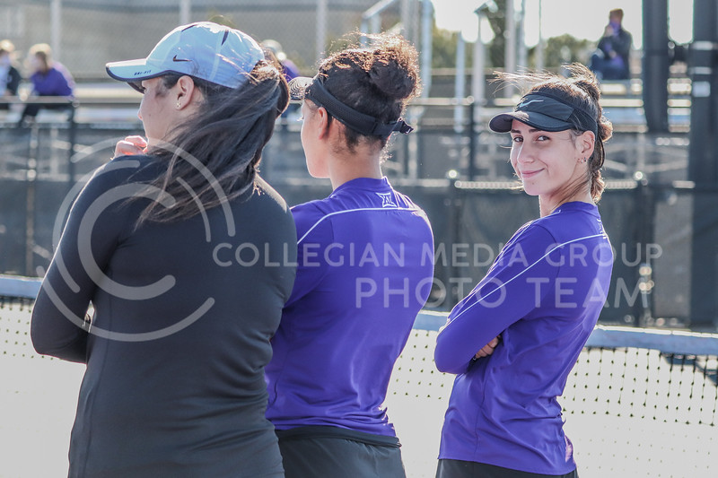 Junior Ioana Gheorghita smirks while cheering on her teammates in the doubles matches of the Fall Invitational hosted by K-State at Mike Goss Tennis Stadium on October 31.<br /> (Macey Franko | Collegian Media Group)