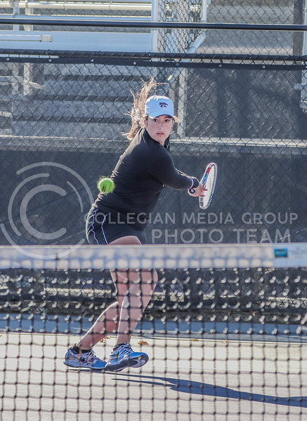 With her arms back, junior Maria Linares gets ready to return the ball. Linares competed with her doubles partner junior Karine-Marion Job in Day 2 of the Fall Invitational where K-State hosted KU and Iowa State in a three day tournament.<br /> (Macey Franko | Collegian Media Group)