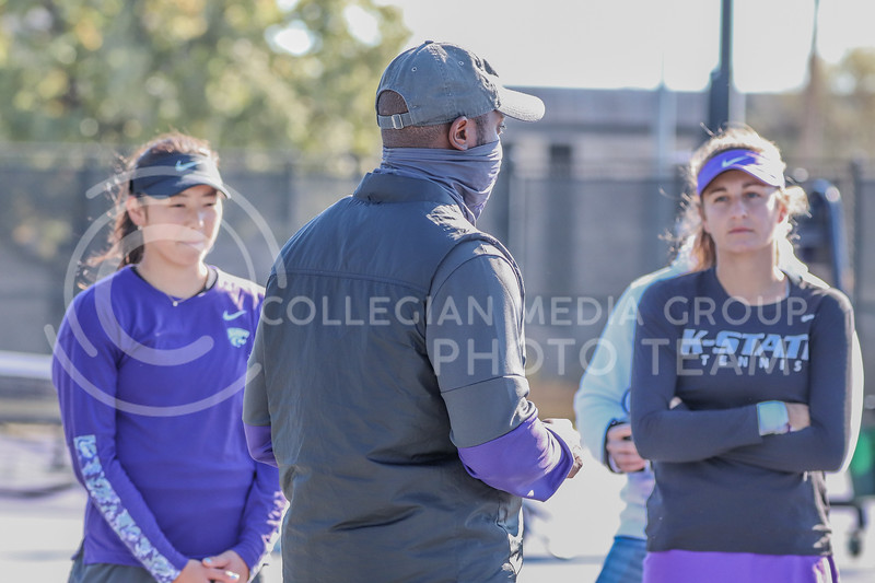 Head Coach Jordan Smith addresses the doubles teams after the first round of matches on Day 2 of the Fall Invitational that took place on October 31.<br /> (Macey Franko | Collegian Media Group)