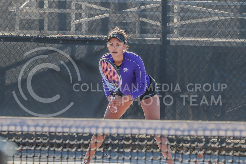 Awaiting a serve, junior Karine-Marion Job competes in Day 2 of the Fall Invitational hosted by Kansas State on October 30 through November 1. <br /> (Macey Franko | Collegian Media Group)