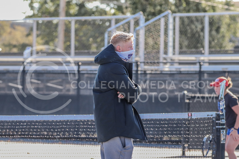 Assistant coach Logan Burgess Hayes watches a match. The fall 2020 season is his first season as a part of the tennis coaching staff, serving as a volunteer assistant coach. <br /> (Macey Franko | Collegian Media Group)