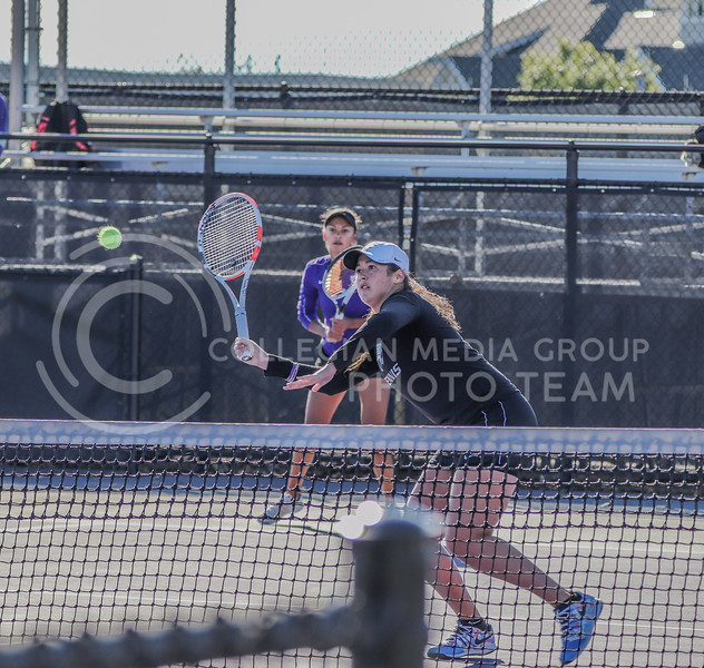 About to hit the ball, junior Maria Linares moves her tennis racket. Linares and Job played against Iowa State in their first match of the day on October 31. <br /> (Macey Franko | Collegian Media Group)