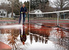HOLLY PELCZYNSKI - BENNINGTON BANNER Dan Taylor, worker for the parts and recs department cleans debris from the tennis courts at the Bennington rec Center on Thursday in Bennington.