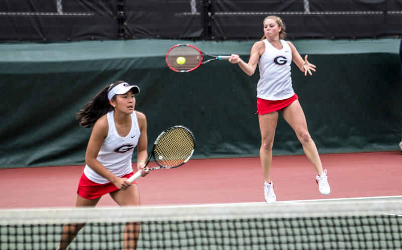 Georgia's Mariana Gould and Marta Gonzalez during the Bulldogs' match with Mercer at the Dan Magill Tennis Complex in Athens, GA on Wednesday, Feb. 22, 2017.  (Photo by John Paul Van Wert / Georgia Sports Communications)