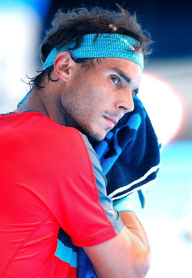 Rafael Nadal of Spain towels off at The Australian Open, 2014