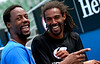 Gael Monfils of France and Dustin Brown of Germany have fun during a practice session at the Australian Open, 2014