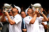 Bob and Mike Bryan kiss their trophies in the Men's Doubles Final at Wimbledon, 2011