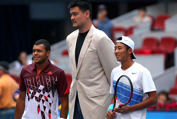 Yao Ming, the recently retired Chinese basketball player, meets Jo-Wilfried Tsonga and Zhang Ze, Beijing, 2011